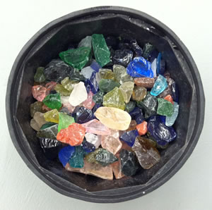 Rough glass in a tumbler barrel